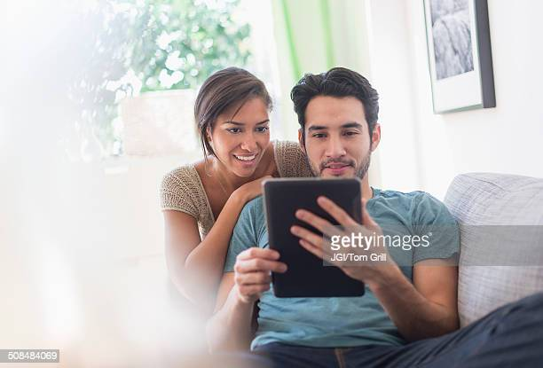 Couple using digital tablet together