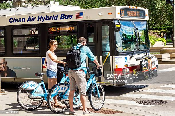 A couple using Divvy Bike Share Program system rental bicycles