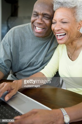 Couple using laptop computer : Stock Photo
