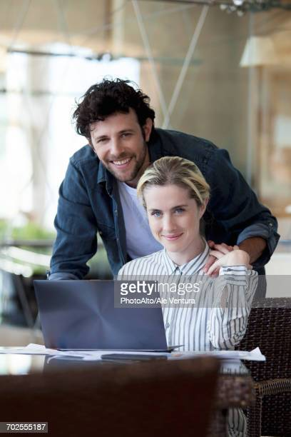 Couple using laptop computer together