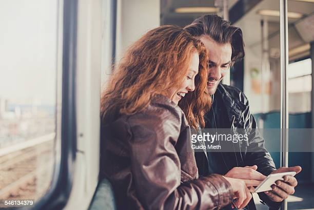 Couple using smartphone together.