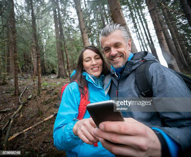 Couple using technology in the middle of nowhere