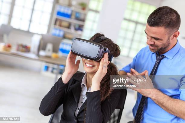 Couple using VR headset at work