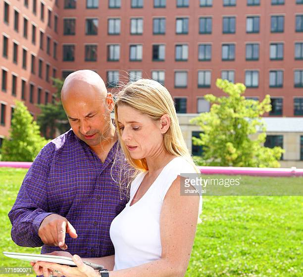 couple viewing properties on an Ipad