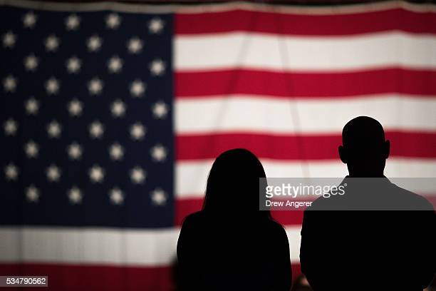 A couple views a large American flag set up on the National Mall May 27 in Washington DC Rolling Thunder members and supporters will participate in a...