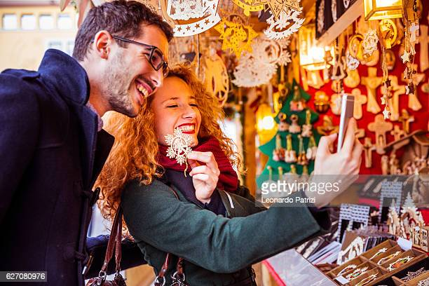 Couple visiting and having fun in a Christmas Market