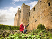 Couple visiting Bolton Castle, a 14th century Grade I listed building and a Scheduled Ancient Monument.  Mary Queen of Scots resided here in the 16th century.  It is a popular tourist destination
