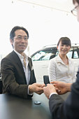 A Couple Visiting Car Dealer