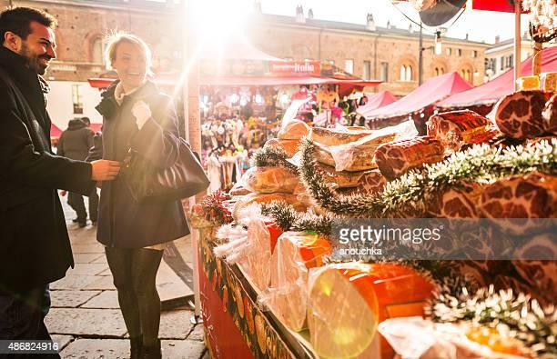 Couple visiting Christmas Market, Milan