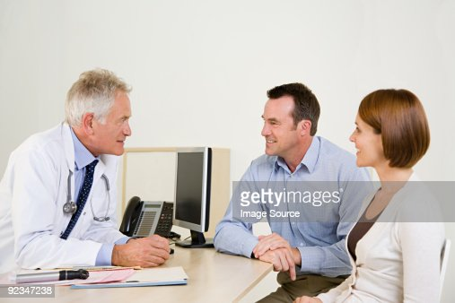 Couple visiting doctor : Stock Photo