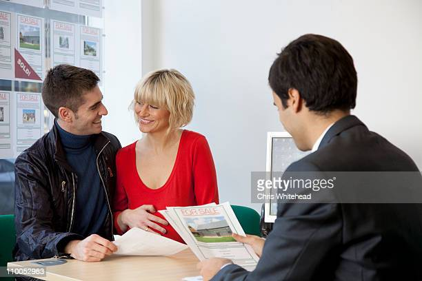 Couple visiting estate agents office
