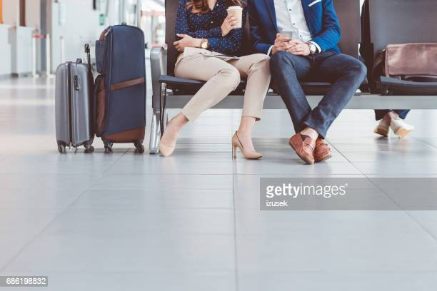 Couple waiting for flight in airport lounge