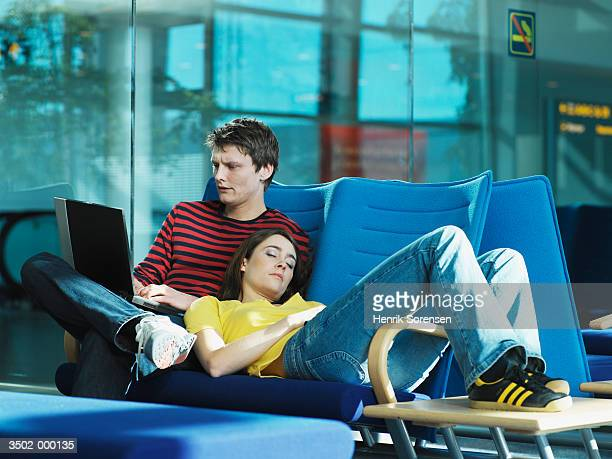 Couple Waiting in Airport