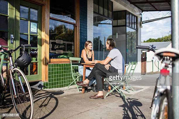 Couple waiting to be served at an sidewalk coffee shop