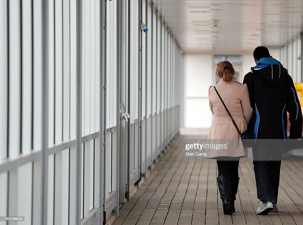 A couple walk along the promenade on the Grand Pier on February 21, 2013 in Weston-Super-Mare, England. According to recently released figures by the Ministry Of Justice, Weston-super-Mare has the highest rate of divorce in the UK.