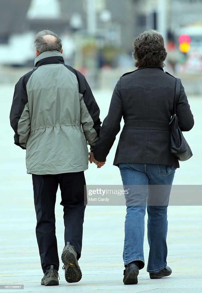 A couple walk along the seafront on February 21, 2013 in Weston-Super-Mare, England. According to recently released figures by the Ministry Of Justice, Weston-super-Mare has the highest rate of divorce in the UK.