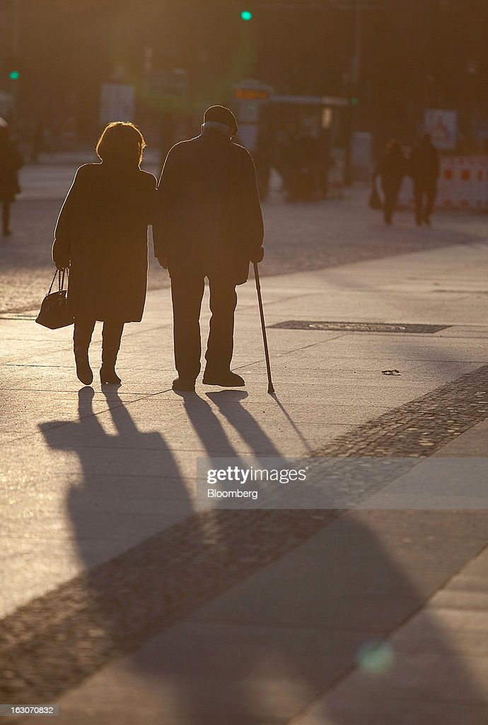 A couple walk along Unter den Linden in the Mitte district in Berlin, Germany, on Sunday, March 3, 2013. Germany's 10-year government bonds advanced for a second day even before a report that economists said will show producer prices in the euro area increased for the first time in four months in January. Photographer: Krisztian Bocsi/Bloomberg via Getty Images