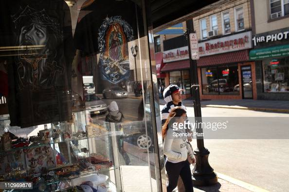 A couple walk by a Hispanic store specializing in religious iconography on March 28 2011 in Union City New Jersey Union City New Jersey one of the...