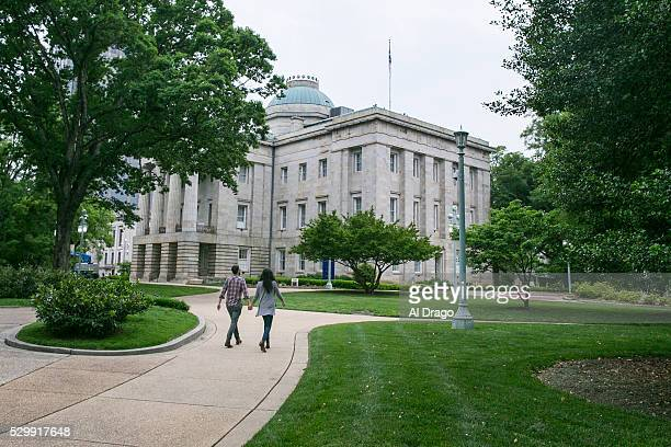 STATES MAY 9 A couple walk near the North Carolina State Capitol in Raleigh NC on Monday May 9 2016 Gov Pat McCrory and his administration sued the...