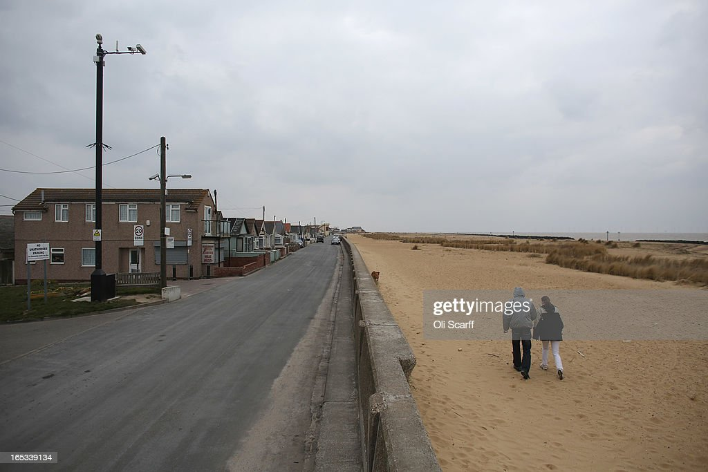 A couple walk on the beach in the seaside town of East Jaywick, the most deprived place in England, on April 3, 2013 in Jaywick, England. The Government's 2011 Indices of Multiple Deprivation' measure ranks Jaywick as the most deprived of all 32,482 small wards in England and Wales. The area also has the greatest number of young people not in employment, education or training; one third of 16 to 24 year-olds claim Jobseeker's Allowance, compared to the national average of 6 per cent. Changes to the benefits and tax system which came into force on April 1, 2013 have included a cut in housing benefit payments for working-age social housing tenants whose property is deemed larger than they need and council tax support payments now being administered locally.