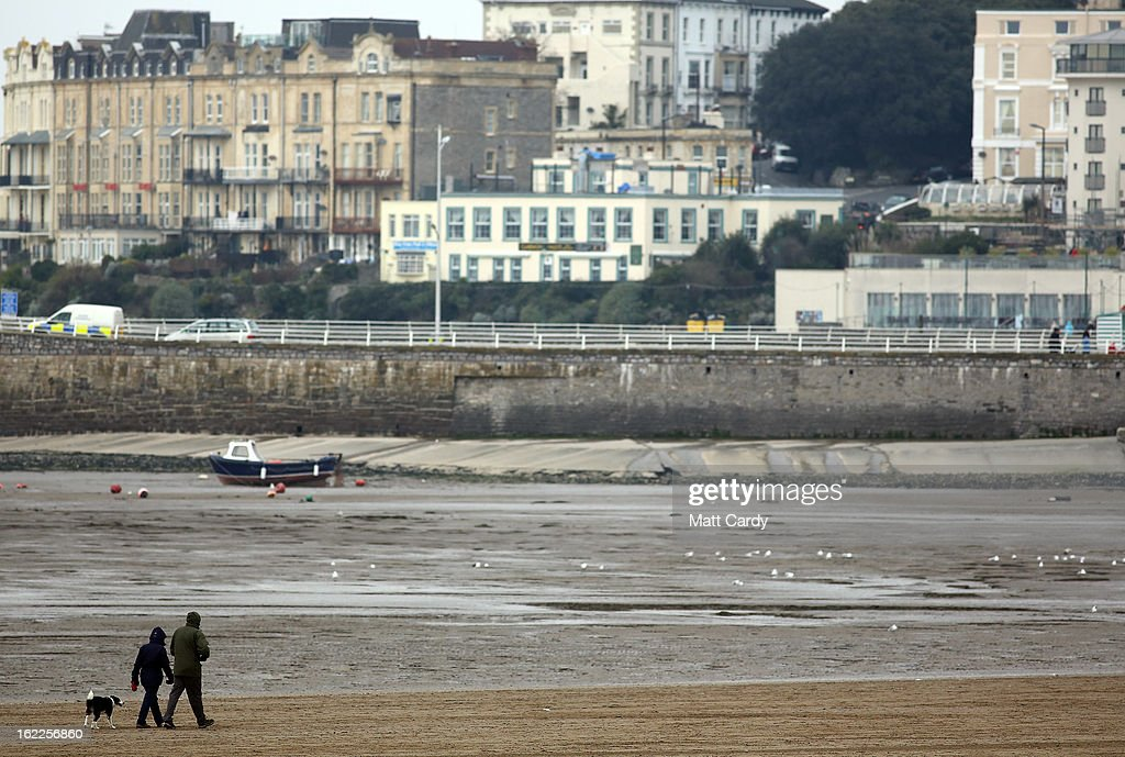 A couple walk on the beach on February 21, 2013 in Weston-Super-Mare, England. According to recently released figures by the Ministry Of Justice, Weston-super-Mare has the highest rate of divorce in the UK.