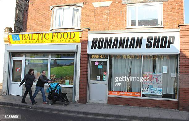 A couple walk past shops catering for eastern Europeans in Boston in Lincolnshire eastern England on February 19 2013 Census data shows that more...