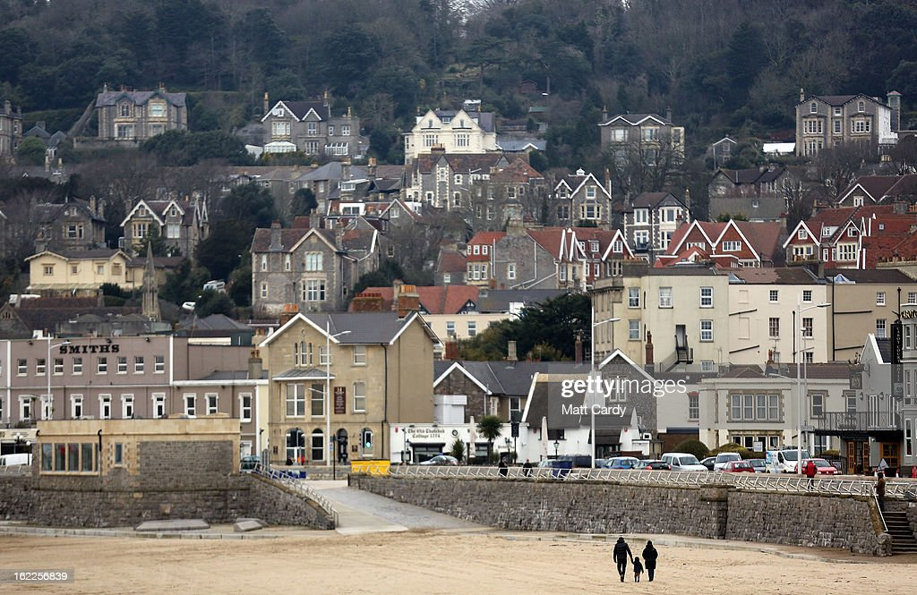 A couple walk with a child on the beach on February 21, 2013 in Weston-Super-Mare, England. According to recently released figures by the Ministry Of Justice, Weston-super-Mare has the highest rate of divorce in the UK.