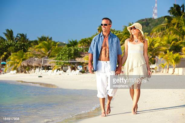 Couple Walking Along Beach