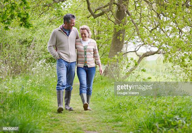 Couple walking along country path.