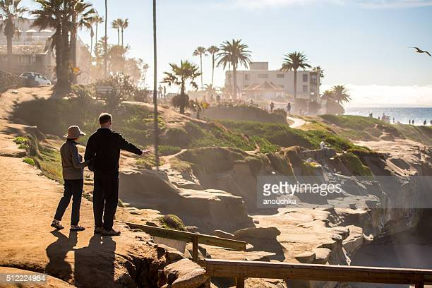 Couple walking along La Jolla beach, California, USA