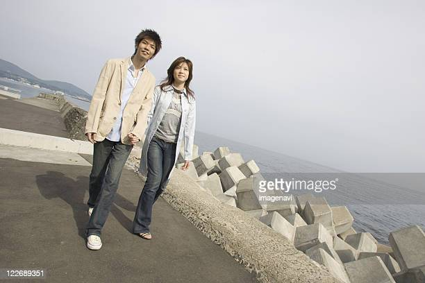 Couple walking along river bank