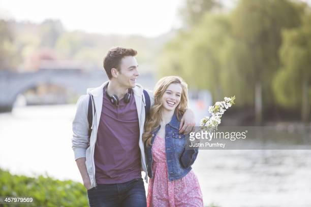 Couple walking along river