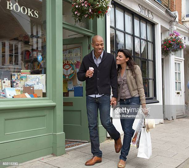 couple walking along street together