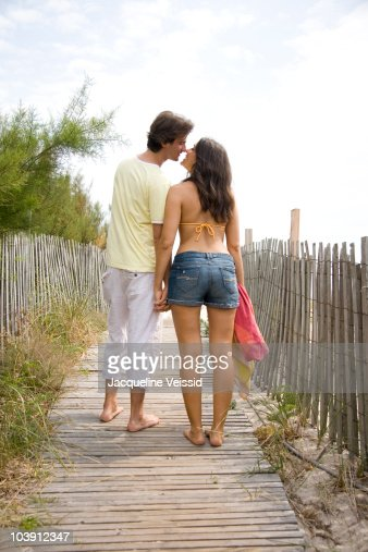 Couple Walking Away Holding Hands Stock Photo | Getty Images