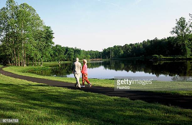 Couple Walking By The Lake