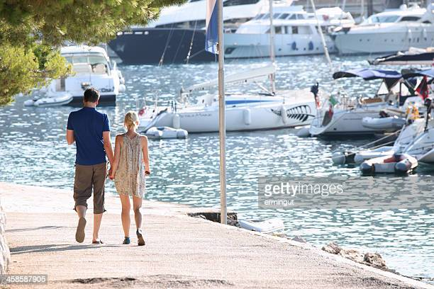 Couple walking by the sea in Hvar city