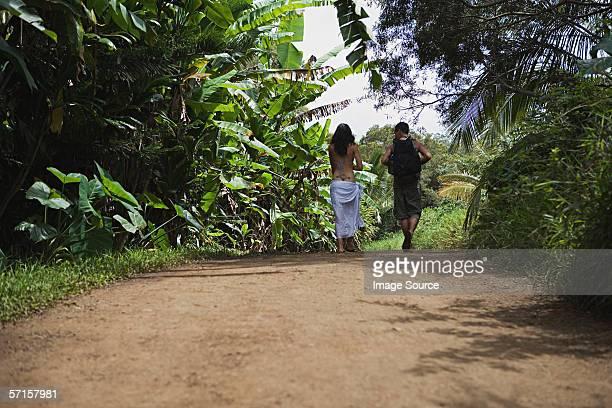 couple walking down dirt road