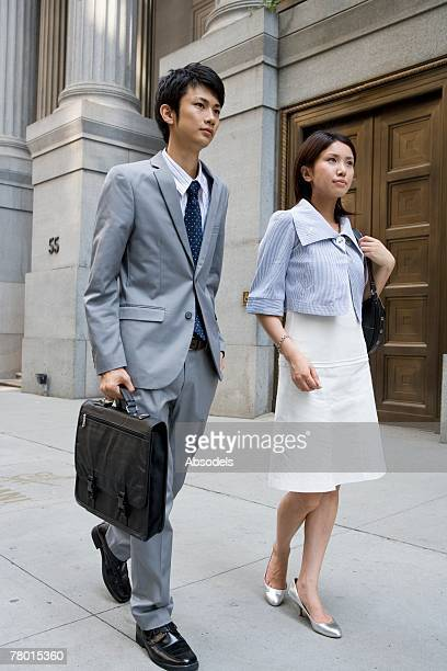 Couple Walking Down Street