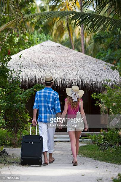 Couple walking hand-in-hand at resort