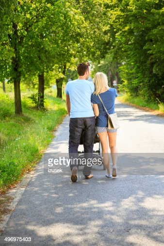 couple walking in a park stock photo getty images