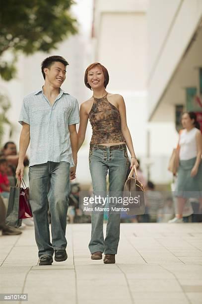Couple walking in street, hand in hand