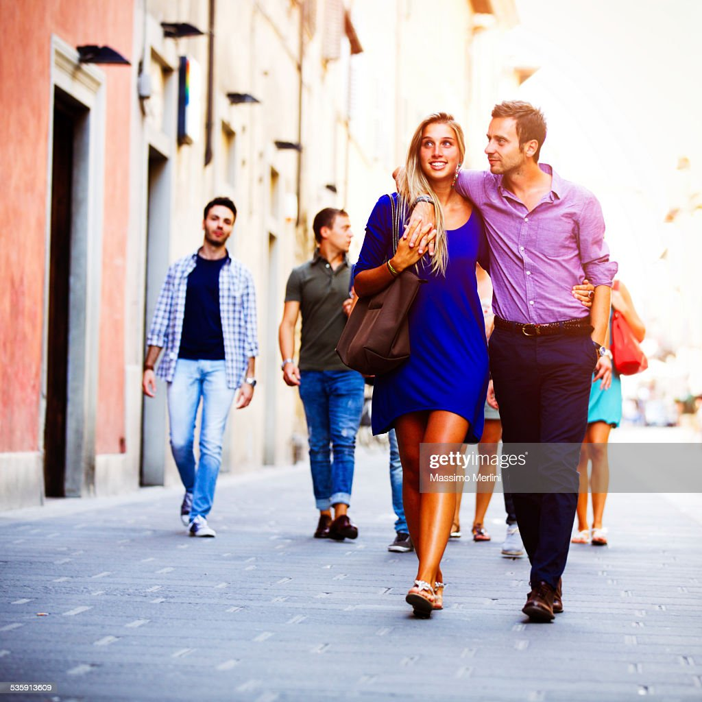 Couple walking in the city : Stock Photo