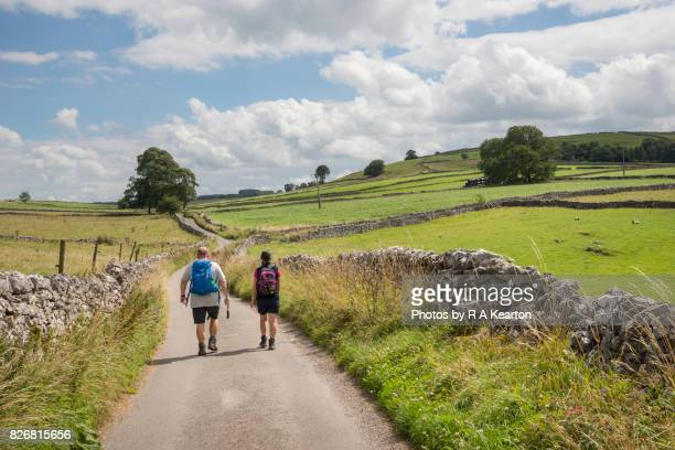 Couple walking in the Peak District countryside
