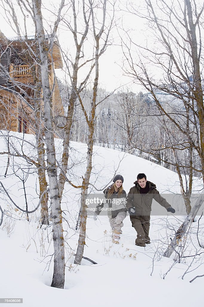 Couple walking in the snow : Stock Photo
