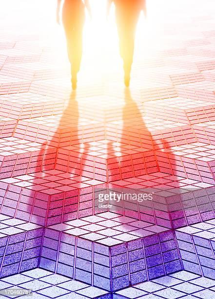 Couple walking into the bright light, future