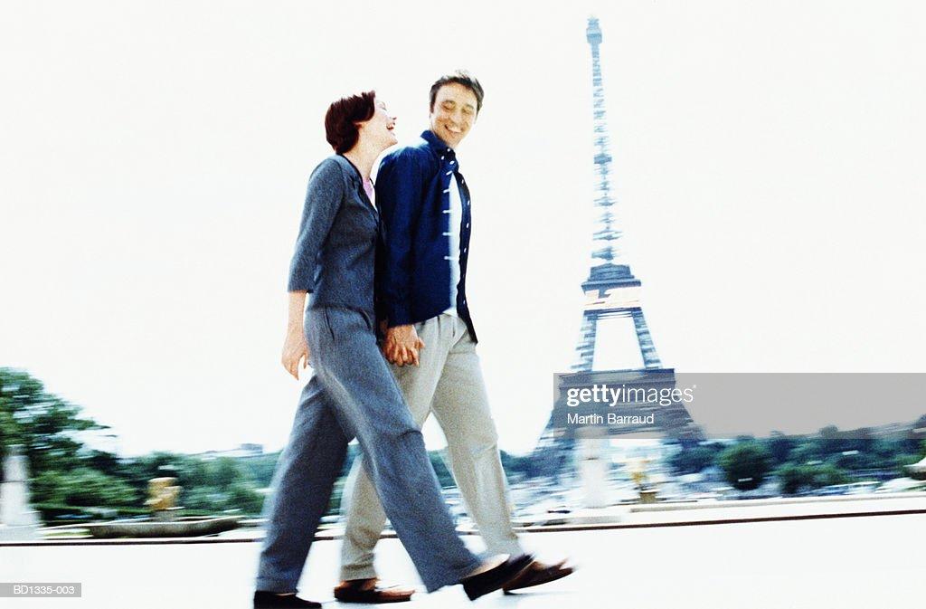 Couple walking near Eiffel Tower, Paris, France (cross-processed) : Stock Photo