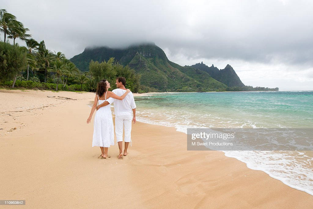 Couple walking on beach, Kauai