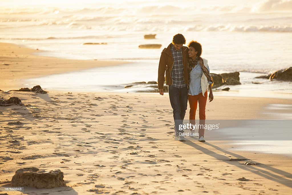 Couple walking on beach : Stock Photo