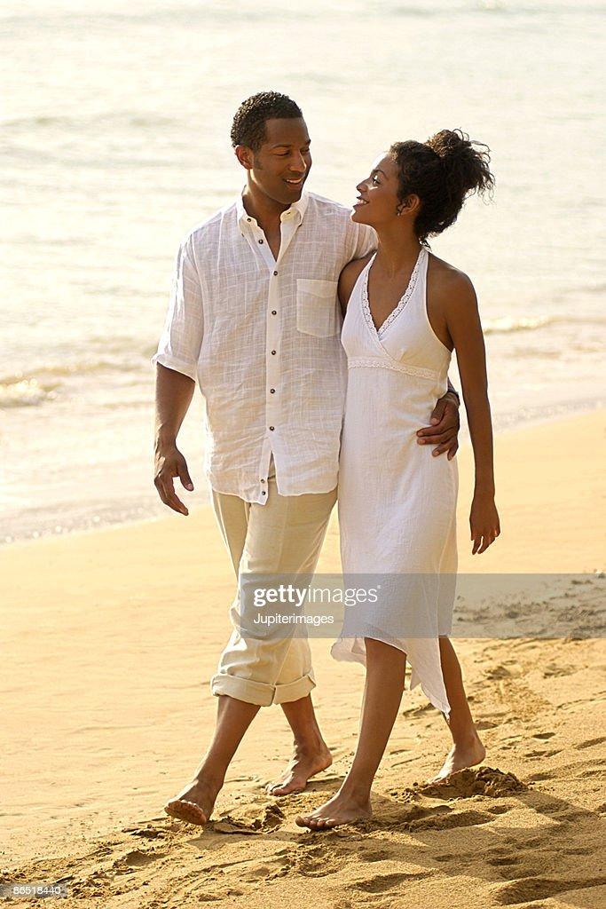 Couple walking on beach : Stock Photo