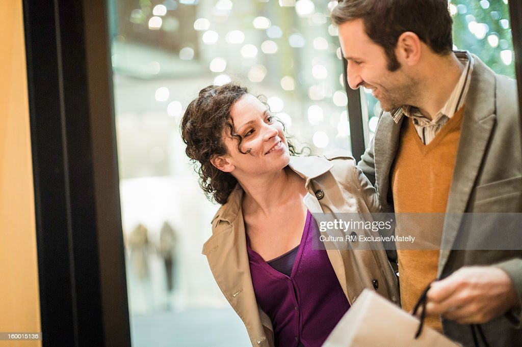 Couple walking on city street : Stock Photo